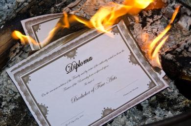 bigstock-Burning-Diploma-53068795